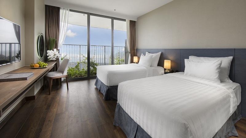 Phòng ngủ ở Flamingo Cát Bà Beach Resort
